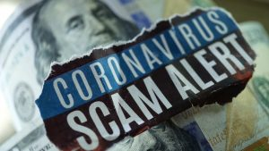 Coronavirus scam alert on dollar bill